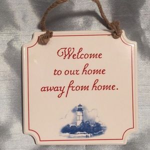 White porcelain wall hanging.  Welcome to our home